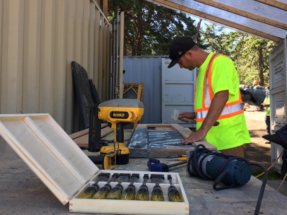 Carpenter Justin Robertson works on a door as part of a multi-million dollar restoration of the historic Fort Rodd Hill site in Colwood. July 24, 2018. (CTV Vancouver Island)