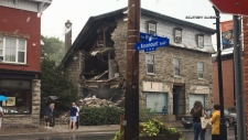 A wall of the historic Magee House on Wellington St. W. collapsed Tuesday night. Crews are working to determine the structural integrity of the building and if it will need to be torn down. (CTV Ottawa/Bryan McNab, July 24, 2018)