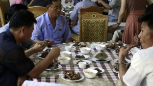 Food are served on a table during the lunch time at Pyongyang House of Sweet Meat, a restaurant specialized in dishes made of dog meat, in Pyongyang, North Korea on Wednesday, July 25, 2018. (AP Photo/Dita Alangkara)