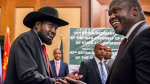 FILE - In this file photo dated Thursday, June 21, 2018, South Sudan's President Salva Kiir, left, and opposition leader Riek Machar, right, shake hands during peace talks in Addis Ababa, Ethiopia. (AP Photo/Mulugeta Ayene, FILE)