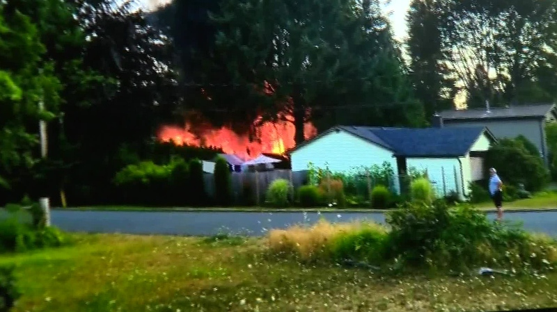 Flames could be seen shooting from the back of a Comox property after fire broke out. July 25, 2018. (CTV Vancouver Island)