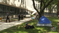 Tent city relocates outside regional headquarters