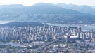 The downtown Vancouver skyline is seen in this image from CTV's Choper 9 on July 25, 2018. (Gary Barndt / CTV Vancouver)