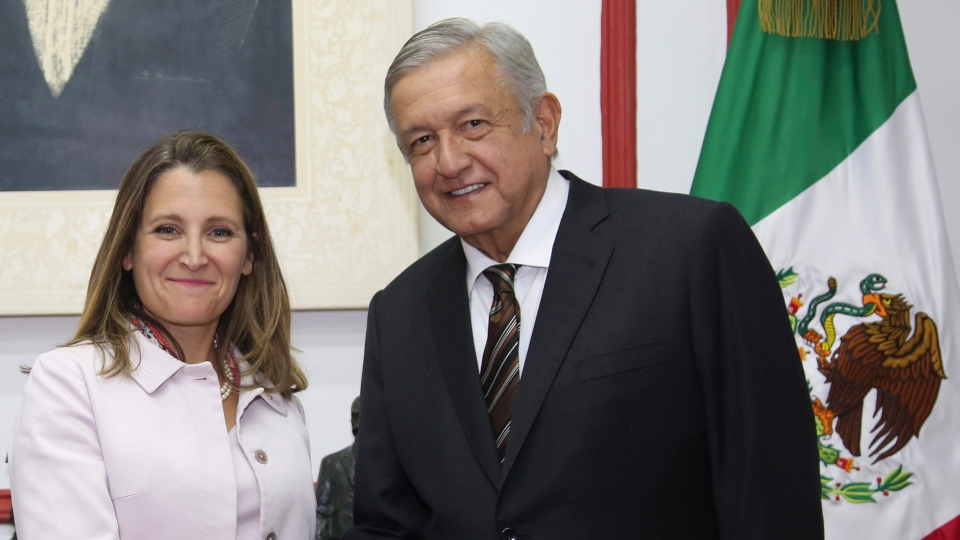 Canada's Foreign Affairs Minister Chrystia Freeland, left, and Mexico's then-President-elect Andres Manuel Lopez Obrador, pose for a photo in Mexico City, Wednesday, July 25, 2018. (Press Office of Andres Manuel Lopez Obrador via AP)