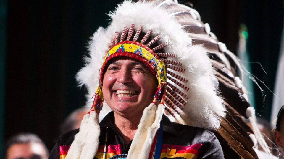 Perry Bellegarde is sworn in after being re-elected as the National Chief of the Assembly of First Nations in Vancouver, B.C., on Wednesday July 25, 2018. He won 328 of the 522 votes in a second ballot, giving him just over the 60 per cent needed to be elected as leader for a second term. (THE CANADIAN PRESS/Ben Nelms)