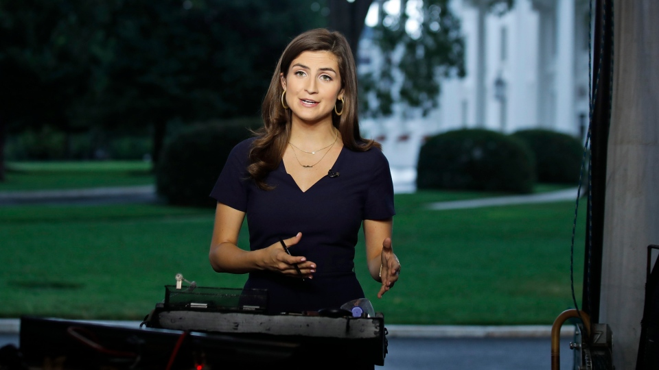 """CNN White House correspondent Kaitlan Collins talks during a live shot in front of the White House, Wednesday, July 25, 2018, in Washington. Collins says the White House denied her access to President Donald Trump's Rose Garden statement with the European Union Commission president because officials found her earlier questions """"inappropriate."""" (Alex Brandon / THE ASSOCIATED PRESS)"""