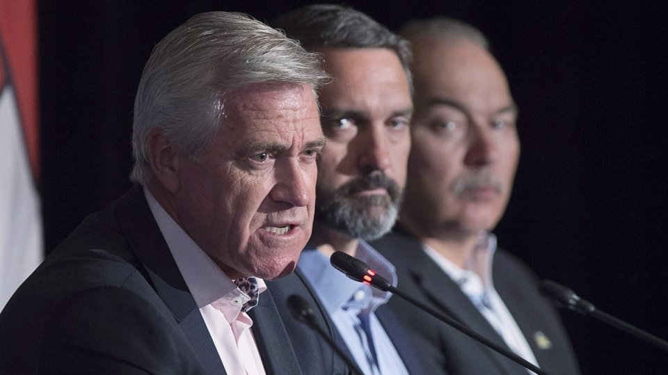 Newfoundland and Labrador Premier Dwight Ball, left, fields a question as Nunavut Premier Joe Savikataaq, right, and Yukon Premier Sandy Silver look on at the closing news conference of the Canadian premiers meeting in St. Andrews, N.B. on Friday, July 20, 2018. (THE CANADIAN PRESS/Andrew Vaughan)