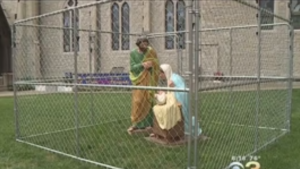 The caged Holy Family display appeared earlier in July.