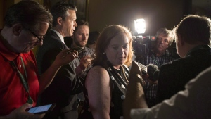 Ontario Minister of Children, Community and Social Services Lisa Macleod turns away after scrumming with reporters at the Ontario Legislature, in Toronto on Thursday, July 5, 2018. THE CANADIAN PRESS/Chris Young