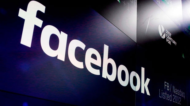 This March 29, 2018 file photo shows the Facebook logo on screens at the Nasdaq MarketSite in New York's Times Square. Facebook plummeted 19 percent Thursday, July 26, 2018, after warning of slower growth ahead, erasing more than $100 billion in value. (AP Photo/Richard Drew, File)