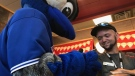 Raymond Hardisty is surprised by the Jays mascot in Stayner, Ont. on Thursday, July 26, 2018. (Beatrice Vaisman/CTV News)
