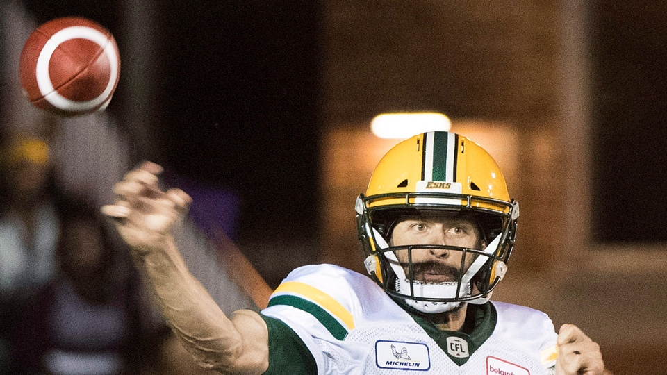 Edmonton Eskimos quarterback Mike Reilly throws a pass during second half CFL football action against the Montreal Alouettes in Montreal, Thursday, July 26, 2018. THE CANADIAN PRESS/Graham Hughes