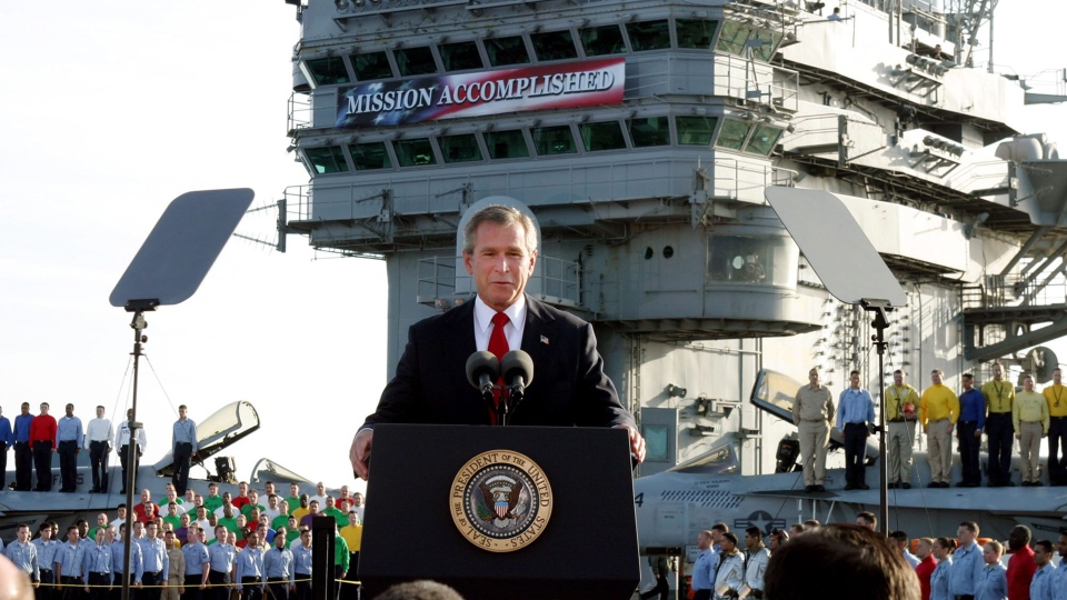 In this May 1, 2003 file photo, President George W. Bush speaks aboard the aircraft carrier USS Abraham Lincoln off the California coast. (AP Photo/J. Scott Applewhite, File)