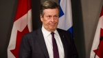 Toronto Mayor John Tory responds to Premier Doug Ford's plan to cut council seats at city hall, in Toronto on Friday, July 27, 2018. THE CANADIAN PRESS/Christopher Katsarov
