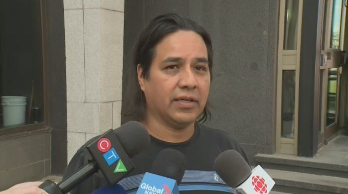 Simon Ash-Moccasin speaks to media on July 27, 2018