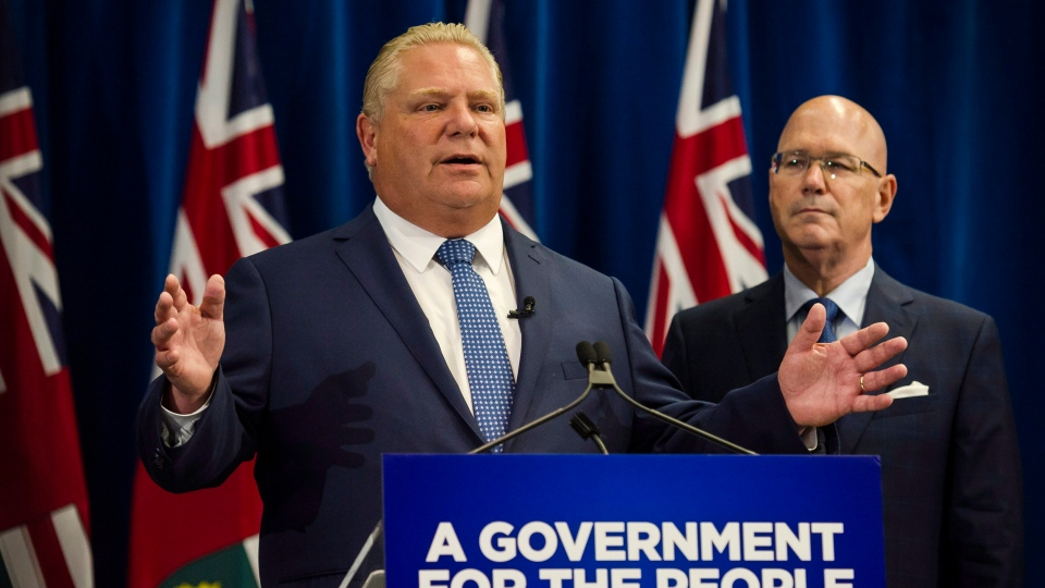 Ontario Premier Doug Ford makes an announcement at Queen's Park in Toronto, on Friday, July 27, 2018 as Municipal Affairs and Housing Minister Steve Clark looks on. Ford says he will significantly reduce the number of Toronto city councillors just months before the fall municipal election.THE CANADIAN PRESS/Christopher Katsarov