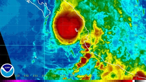 The first tropical depression of the Pacific hurricane season approaches the coast of Mexico as seen in this NOAA satellite image taken Friday, June 19, 2009.