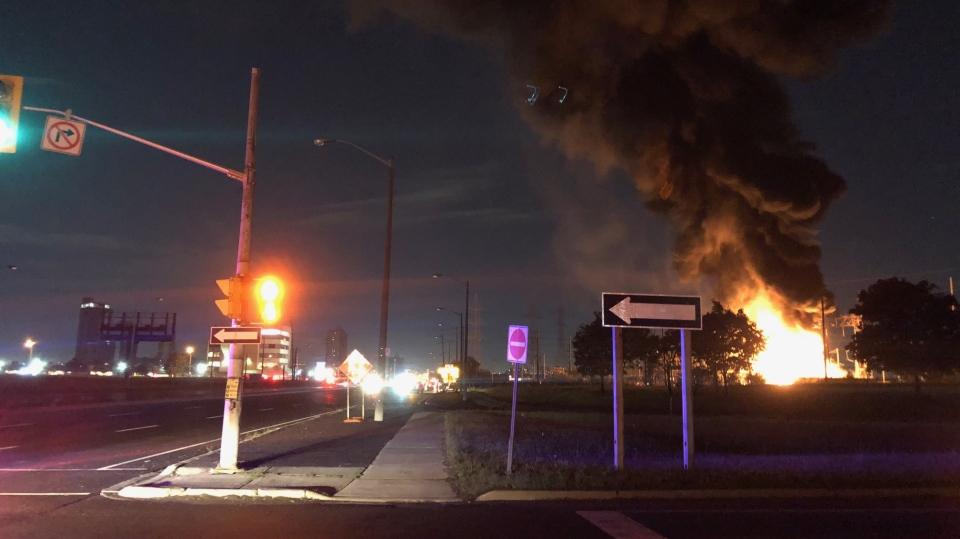 Flames are seen coming from a transformer station fire near Finch Avenue and Signet Drive early Saturday morning. (Peter Muscat)