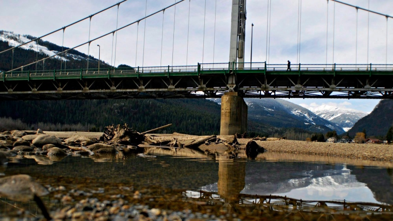 A man crosses a bridge over the Columbia River in Revelstoke, B.C., on March 14, 2010. THE CANADIAN PRESS/Daniel Hayduk