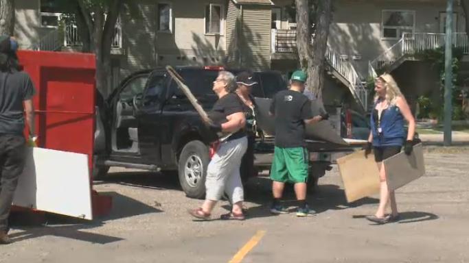 Volunteers working to clean up the Heritage neighbourhood on Saturday, July 28, 2018.