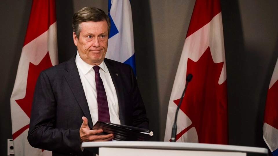 "Toronto Mayor John Tory speaks to the media at Toronto city hall on Friday, July 27, 2018. Tory says he's told Ontario Premier Doug Ford that the process around a plan to slash the number of city councillors in half is ""absolutely not right."" THE CANADIAN PRESS/Christopher Katsarov"