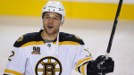Boston Bruins' Jarome Iginla waves to the crowd before first period NHL hockey action against the Calgary Flames in Calgary, Alta., Tuesday, Dec. 10, 2013. THE CANADIAN PRESS/Jeff McIntosh