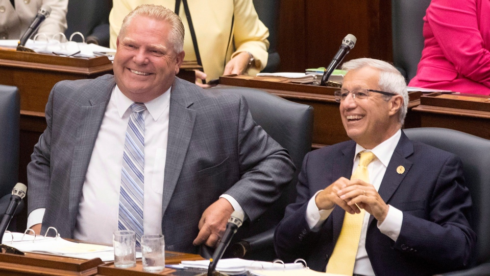 Ontario Premier Doug Ford (left) shares a joke with Finance Minister Vic Fedeli during Question Period at the Ontario Legislature in Toronto on Monday, July 30, 2018.THE CANADIAN PRESS/Chris Young