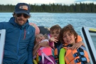 Donald Munro (left) and his eight-year-old son, Cohen (far right) were saved by 14-year-old Jacob Boissonneault (middle right) from drowning on a boating trip. (Courtesy: Donald Munro)