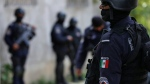 In this June 21, 2018 photo, police officers patrol the poor neighborhoods of Acapulco, Mexico. (AP Photo/Marco Ugarte)