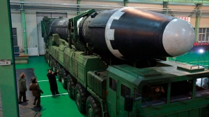 This Nov. 29, 2017, file photo provided by the North Korean government shows North Korean leader Kim Jong Un, third from left, and what the North Korean government calls the Hwasong-15 intercontinental ballistic missile, in North Korea. (Korean Central News Agency/Korea News Service via AP, File)