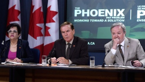 Sen. Percy Mockler, centre, chair of the Standing Senate Committee on National Finance, sits with deputy chairs Sen. Mobina Jaffer, left, and Sen. Andre Pratte, of the Standing Senate Committee on National Finance, listen to questions during a press conference on their report on the Phoenix pay system, in Ottawa on Tuesday, July 31, 2018. THE CANADIAN PRESS/Justin Tang