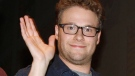 """Actor Seth Rogen waves as he leaves a panel for the movie """"The Green Hornet"""" at Comic-Con International Friday July 23, 2010 in San Diego. (AP Photo/Denis Poroy)"""