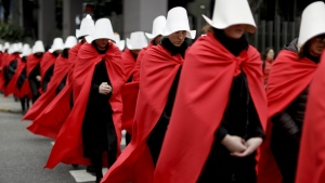 """Women in favour of a measure to expand legal abortions, wearing red cloaks and white bonnets like the characters from the novel-turned-TV series """"The Handmaid's Tale"""", march in silence to Congress, in Buenos Aires, Argentina on July 25, 2018. (AP Photo/Natacha Pisarenko)"""