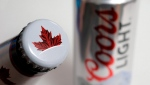 In this Nov. 28, 2017, file photo products from the Mondelez International family of brands, Molson beer, left, and Coors Light beer rest together, in Walpole, Mass. olson Coors Canada, the business arm of Molson Coors Brewing Co., says it has entered into a joint venture to develop non-alcoholic, cannabis-infused beverages. THE CANADIAN PRESS/AP/Steven Senne