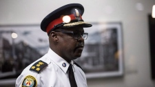 Toronto Police Chief Mark Saunders leaves following a meeting with Toronto Mayor John Tory, Minister of Border Security and Organized Crime Reduction Bill Blair, and Ontario Premier Doug Ford at City Hall in Toronto on Monday, July 23, 2018. (THE CANADIAN PRESS/Nick Kozak)