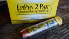This Oct. 10, 2013, file photo, shows an EpiPen epinephrine auto-injector, a Mylan product, in Hendersonville, Texas. (AP Photo/Mark Zaleski, File)
