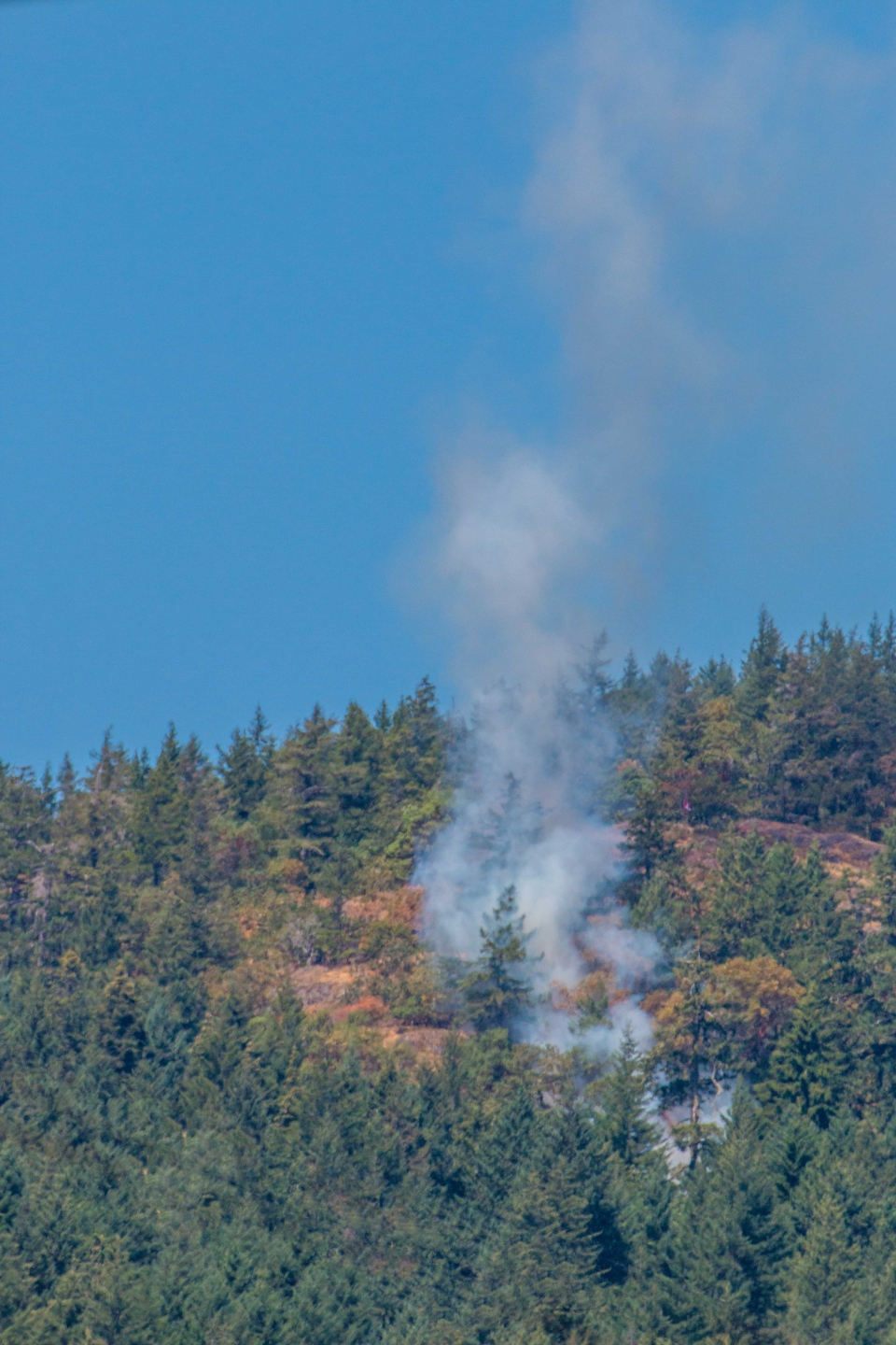 Smoke is seen rising from a brush fire on Skirt Mountain near Langford. Aug. 1, 2018. (Courtesy Sarah White)
