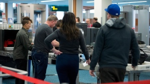 Passengers carry their bags through security screening area at Vancouver International Airport in Richmond, B.C., Monday, Feb. 6, 2017. (THE CANADIAN PRESS/Jonathan Hayward)