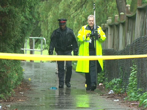 Police investigate a Brampton crime scene where Baden Jeffrey Willcocks was fatally shot on June 19, 2009.