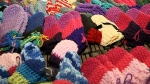 Woman makes mittens to raise awareness of suicide