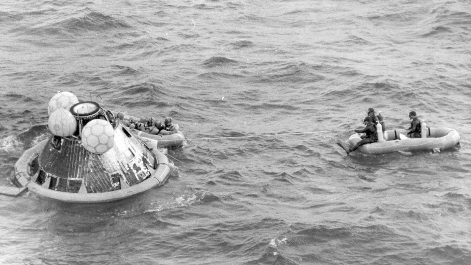 In this July 24, 1969, file photo, the Apollo 11 command module lands in the Pacific Ocean and the crew waits to be picked up by U.S. Navy personnel after an eight day mission to the moon. (AP Photo/File)