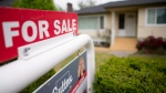 A real estate sign is pictured in Vancouver, B.C., Tuesday, June, 12, 2018. THE CANADIAN PRESS Jonathan Hayward