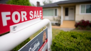 A real estate sign is pictured in Vancouver, B.C., Tuesday, June, 12, 2018. THE CANADIAN PRESS / Jonathan Hayward