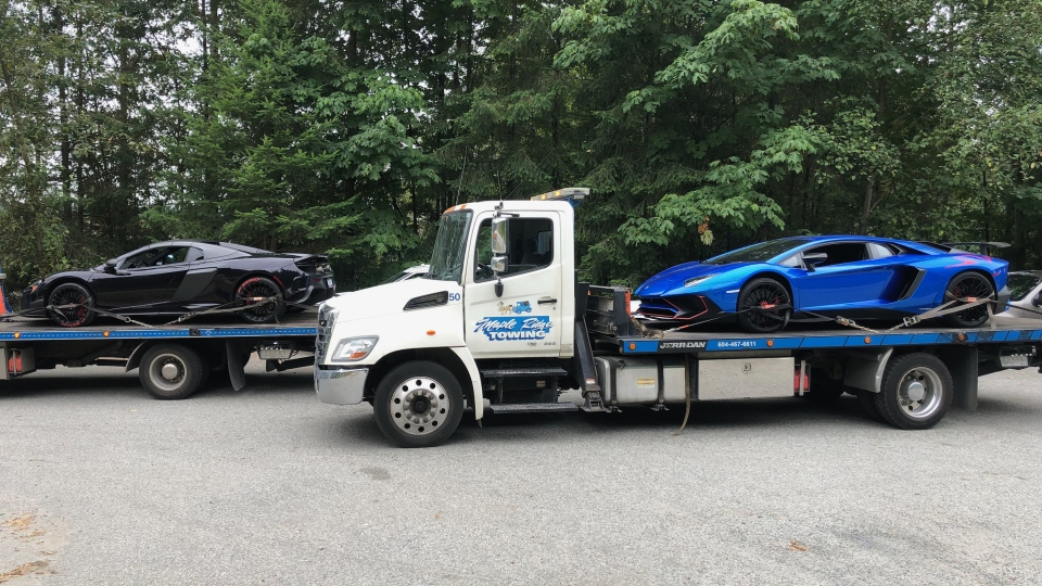 A Lamborghini and a McLaren that were impounded in maple Ridge on Aug. 2, 2018 are seen being towed away. (RCMP)