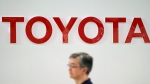 A visitor walks through a Toyota showroom in Tokyo Friday, Aug. 3, 2018. Toyota Motor Corp. has reported its quarterly profit climbed 7.2 percent, helped by strong sales in the U.S. and other overseas markets. (AP Photo/Eugene Hoshiko)