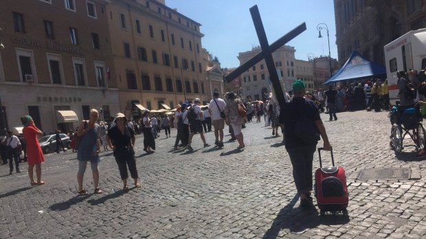 A pilgrim carrying a cross