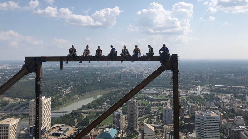 Steel workers have since been disciplined after posing atop of Stantec Tower.