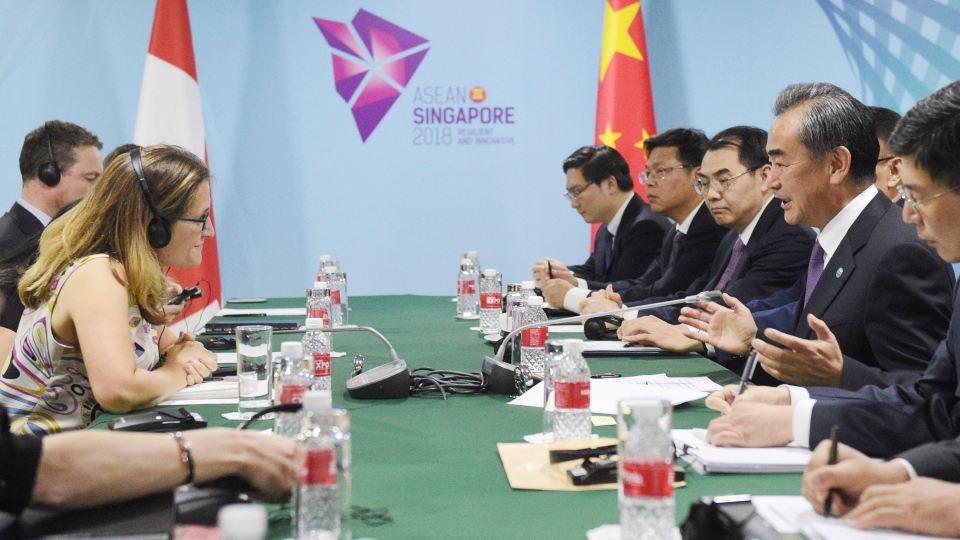 China's Foreign Minister Wang Yi, second right, and Canada's Foreign Minister Chrystia Freeland, first left, at a bilateral meeting on the sidelines of the 51st ASEAN Foreign Ministers Meeting in Singapore, Friday, Aug. 3, 2018. (AP Photo/Joseph Nair)