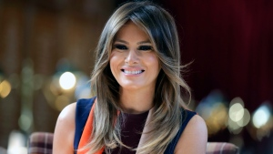 FILE - In this Friday, July 13, 2018 file photo, first lady Melania Trump takes a seat during a visit to The Royal Hospital Chelsea in central London. (AP Photo/Luca Bruno, Pool)