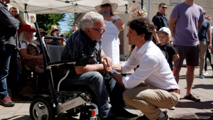 Prime Minister Justin Trudeau meets with Duncan Mayor Phil Kent as he visits locals at the Duncan Farmers Market in Duncan, B.C., on Saturday, August 4, 2018. (THE CANADIAN PRESS/Chad Hipolito)